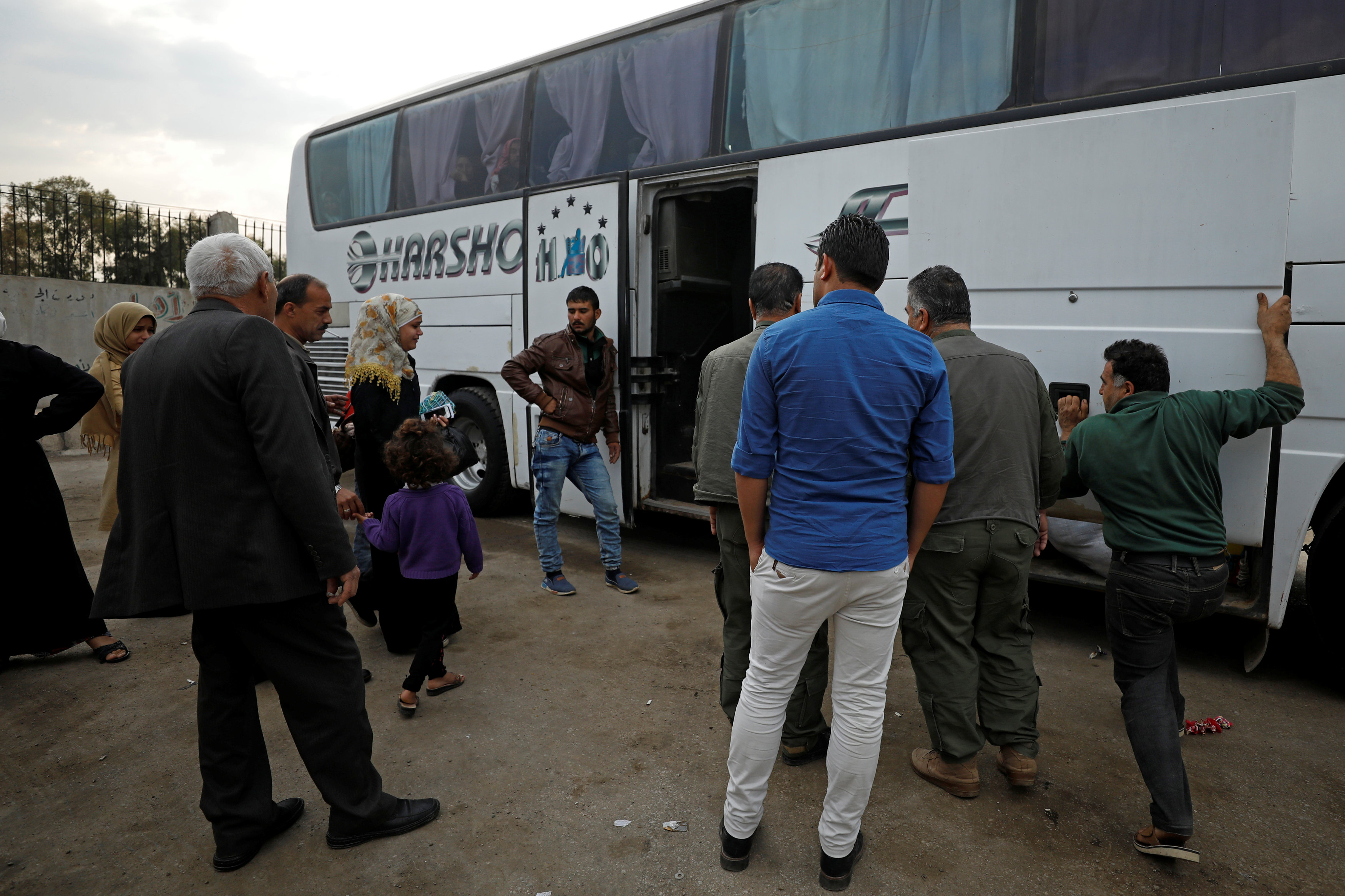 Passengers wait in Qamishli city in Syria's Kurdish-held northeast to embark on a bus headed for government-controlled Aleppo, Syria May 7, 2017. REUTERS/Rodi Said