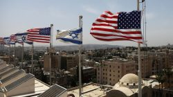 American and Israeli flags flutter in the wind atop the roof of the King David Hotel, in preparation for the upcoming visit of President Trump to Israel, in Jerusalem. REUTERS/Ronen Zvulun