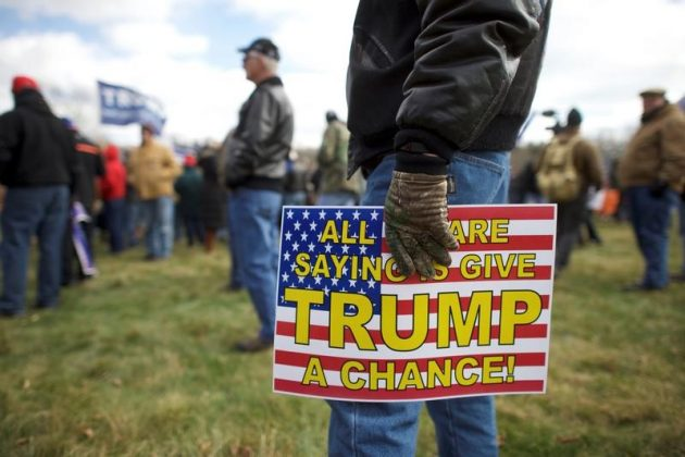 """FILE PHOTO: Supporters of President Donald Trump gather for a """"People 4 Trump"""" rally at Neshaminy State Park in Bensalem, Pennsylvania, U.S. March 4, 2017. REUTERS/Mark Makela"""