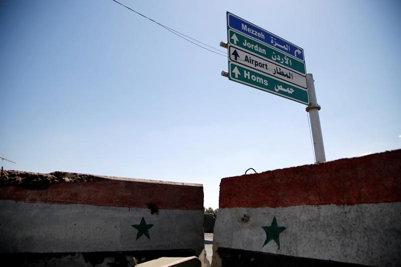 FILE PHOTO: A road sign that shows the direction to Homs is seen in Damascus, Syria April 7, 2017. REUTERS/Omar Sanadiki