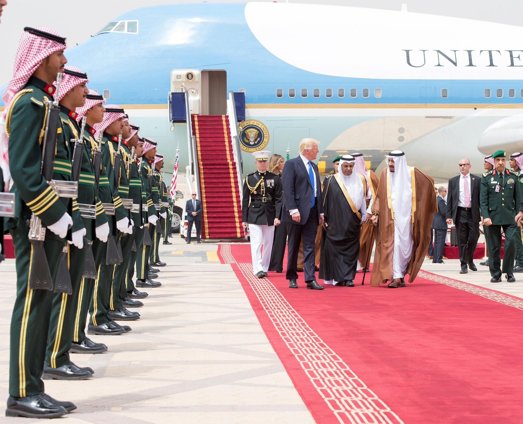 Saudi Arabia's King Salman bin Abdulaziz Al Saud and U.S. President Donald Trump walk during a reception ceremony in Riyadh, Saudi Arabia, May 20, 2017.Bandar Algaloud/Courtesy of Saudi Royal Court/Handout via REUTERS