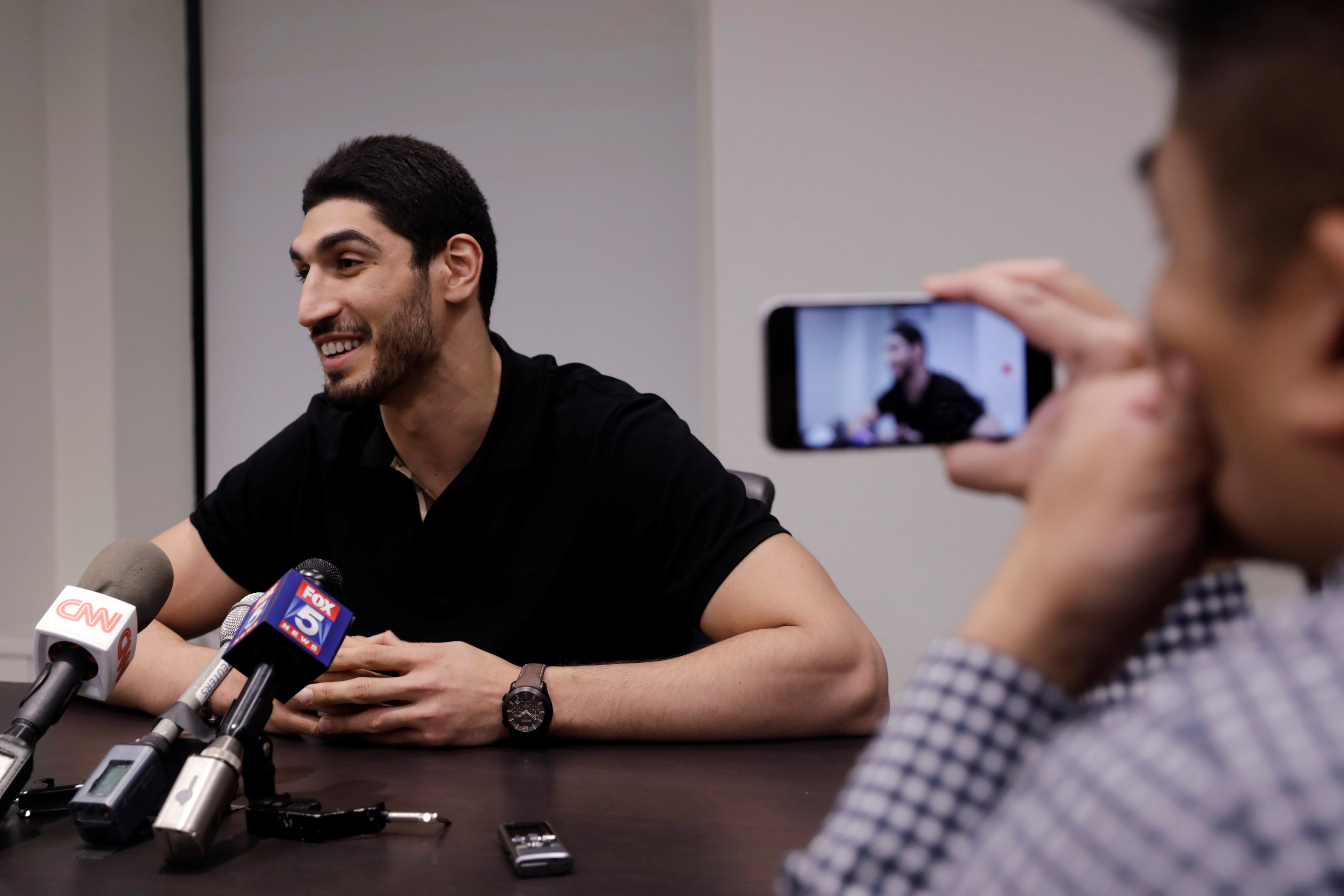 Turkish NBA player Enes Kanter speaks about the revocation of his Turkish passport and return to the United States at National Basketball Players Association headquarters in New York, U.S.,