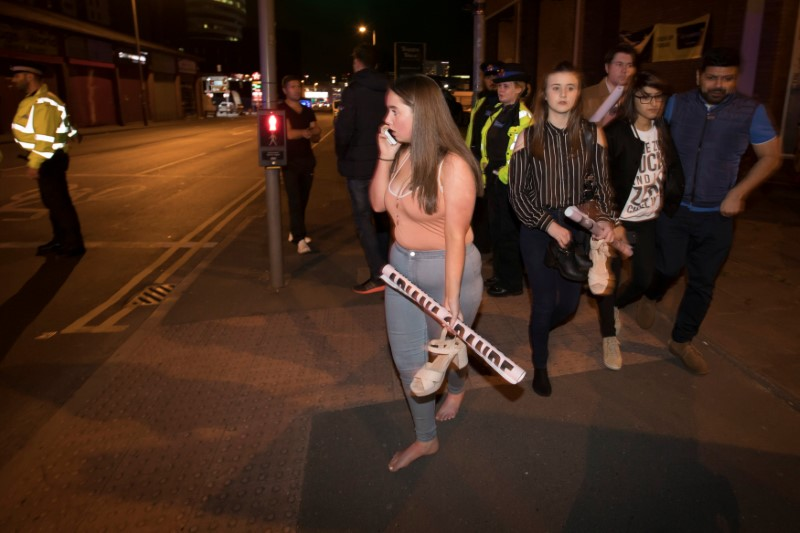 Concert goers react after fleeing the Manchester Arena in northern England where U.S. singer Ariana Grande had been performing in Manchester, Britain,
