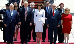 U.S. President Donald Trump (2nd L) and first lady Melania Trump (3rd L) stand with Israeli Prime Minister Benjamin Netanyahu (2nd R), his wife Sara (R) and Israel's President Reuven Rivlin (L) upon their arrival at Ben Gurion International Airport in Lod near Tel Aviv, Israel May 22, 2017. REUTERS/Amir Cohen