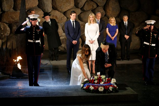 U.S. President Donald Trump and first lady Melania lay a wreath during a ceremony commemorating the six million Jews killed by the Nazis in the Holocaust, in the Hall of Remembrance at Yad Vashem Holocaust memorial in Jerusalem May 23, 2017. REUTERS/Jonathan Ernst