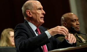 U.S. Director of National Intelligence Dan Coats (L) and Director of the Defense Intelligence Agency Lieutenant General Vincent Stewart testify before the Senate Armed Services Committee on worldwide threats, on Capitol Hill in Washington, U.S., May 23, 2017. REUTERS/Yuri Gripas