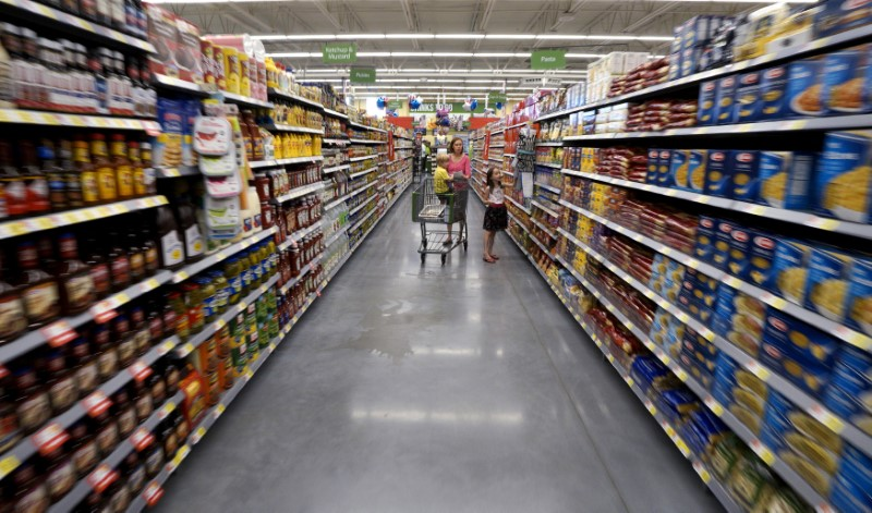 FILE PHOTO - A family shops at the Wal-Mart Neighborhood Market in Bentonville, Arkansas, U.S. on June 4, 2015. REUTERS/Rick Wilking/File Photo