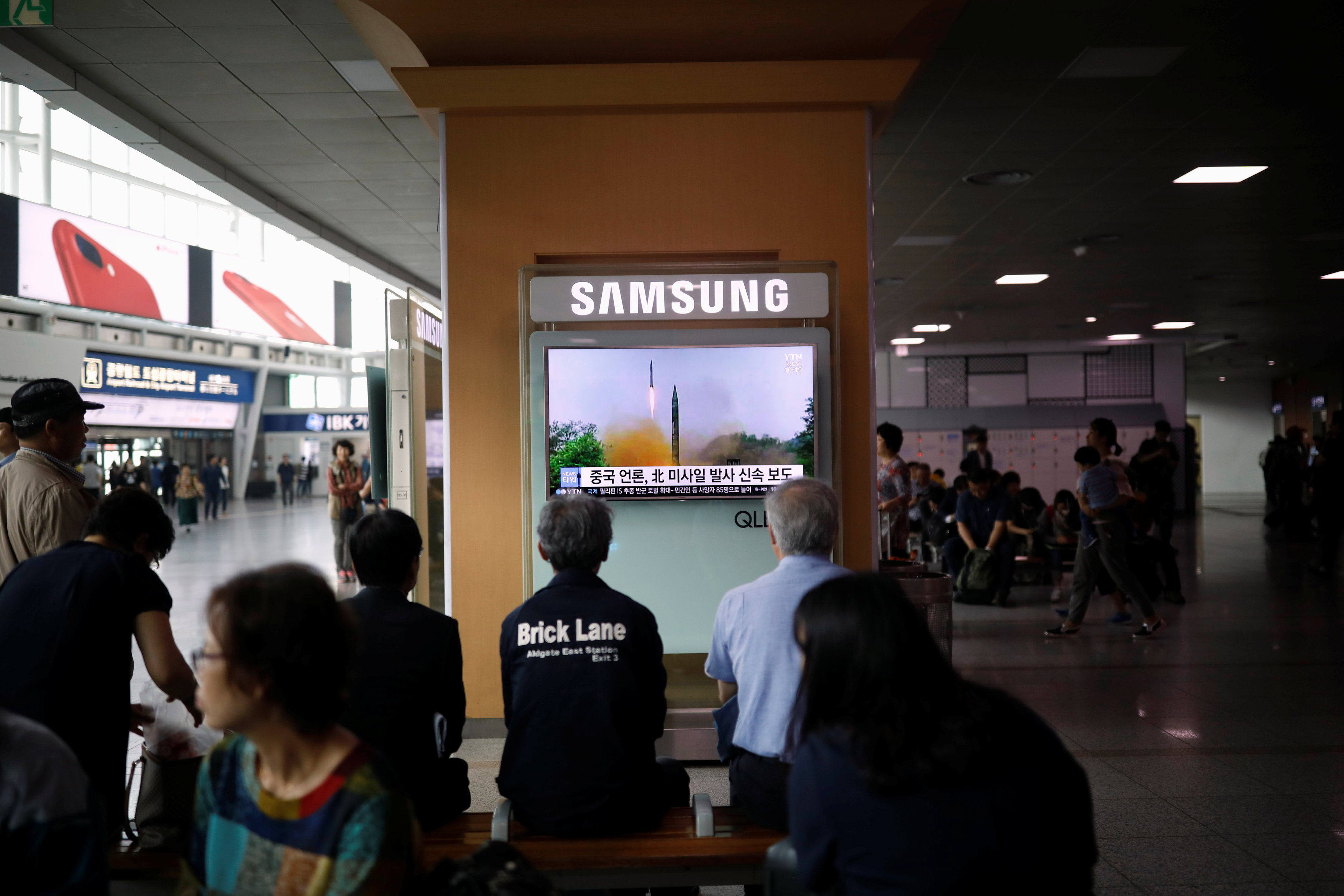 People watch a television broadcasting a news report on North Korea firing what appeared to be a short-range ballistic missile, at a railway station in Seoul, South Korea,