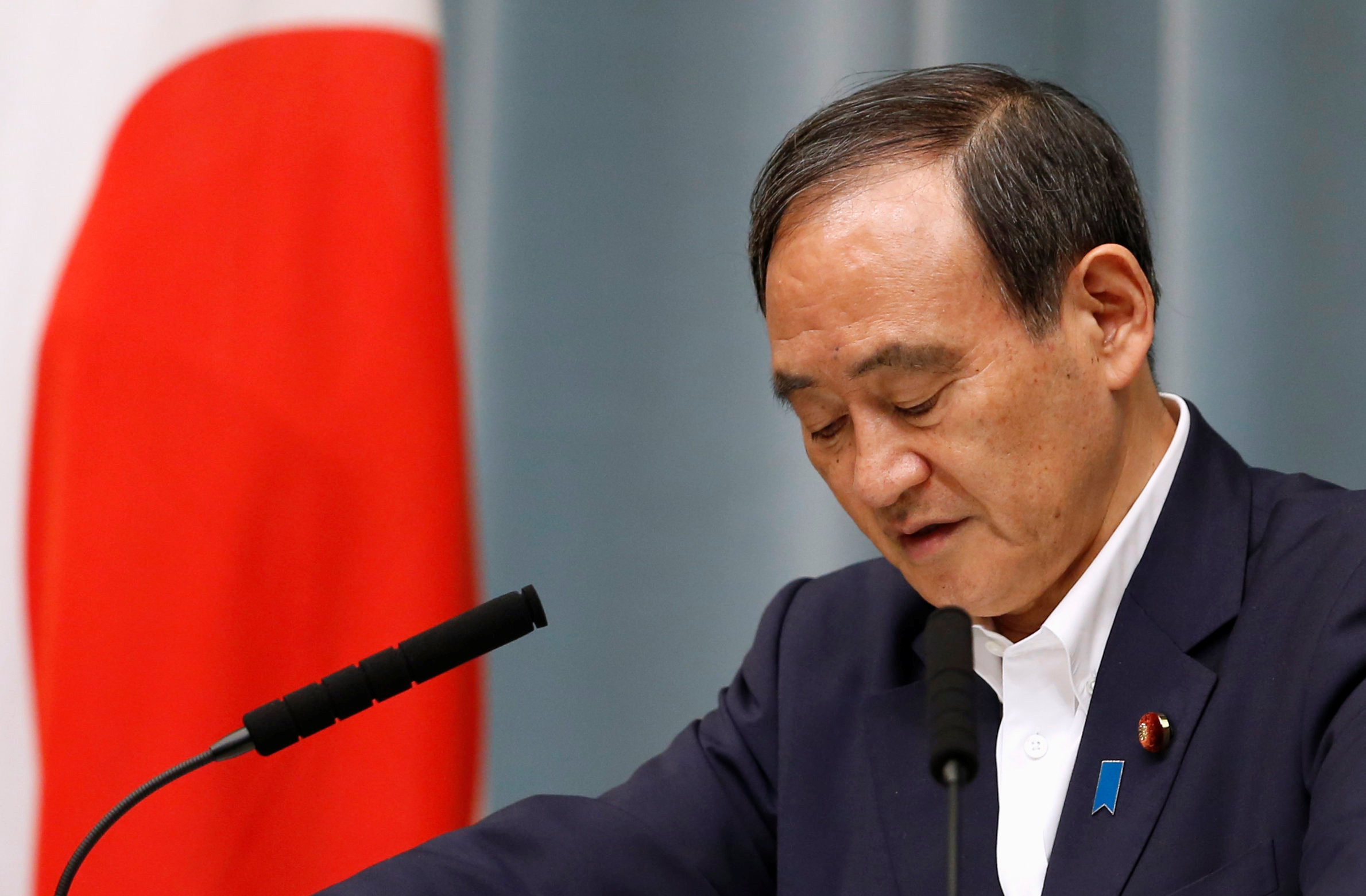 Japan's Chief Cabinet Secretary Yoshihide Suga attends a news conference after the launch of a North Korean missile at Prime Minister Shinzo Abe's official residence in Tokyo, Japan