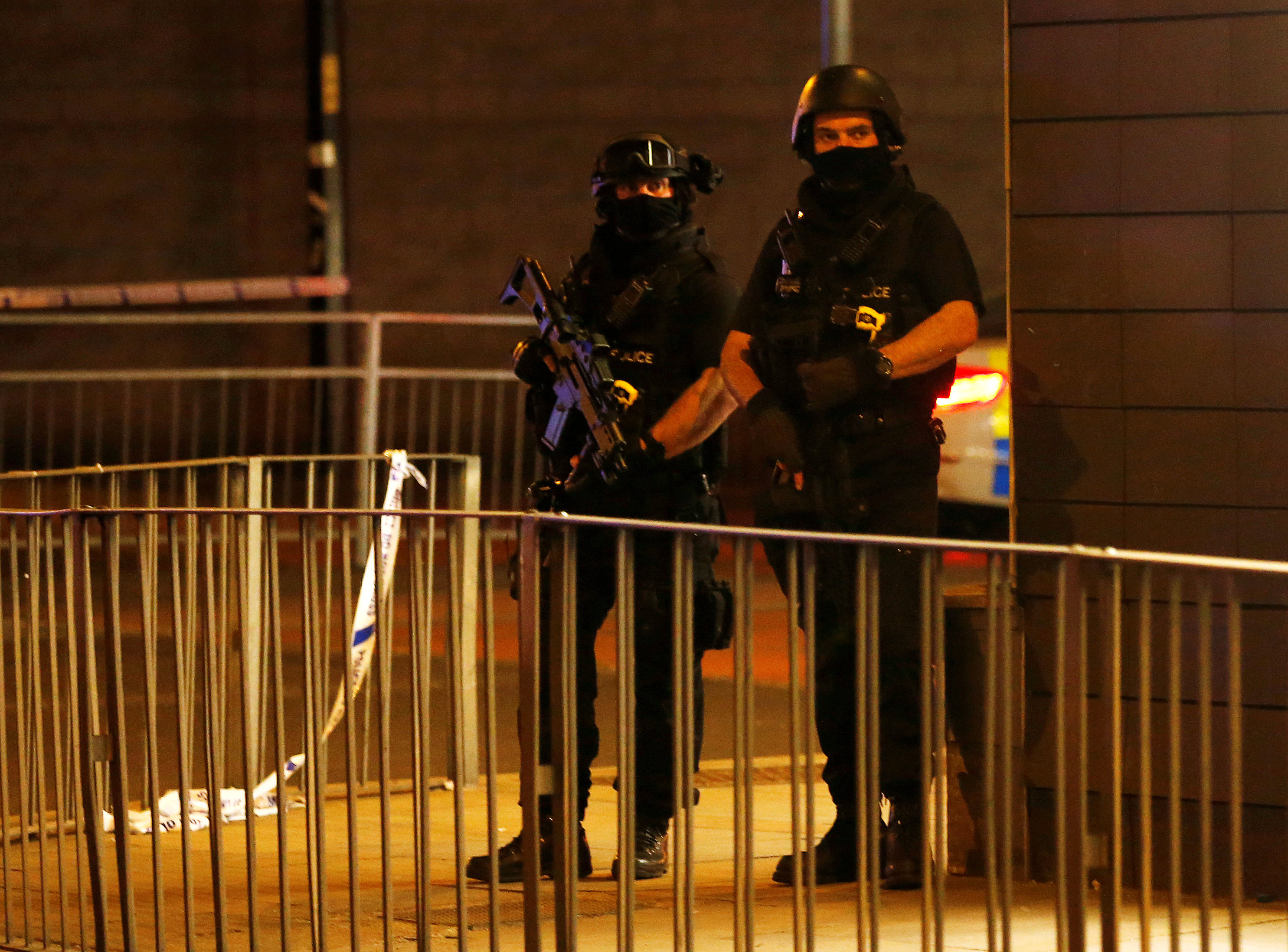 Armed police officers stand next to a police cordon outside the Manchester Arena, where U.S. singer Ariana Grande had been performing, in Manchester, northern England, Britain, May 23, 2017. REUTERS/Andrew