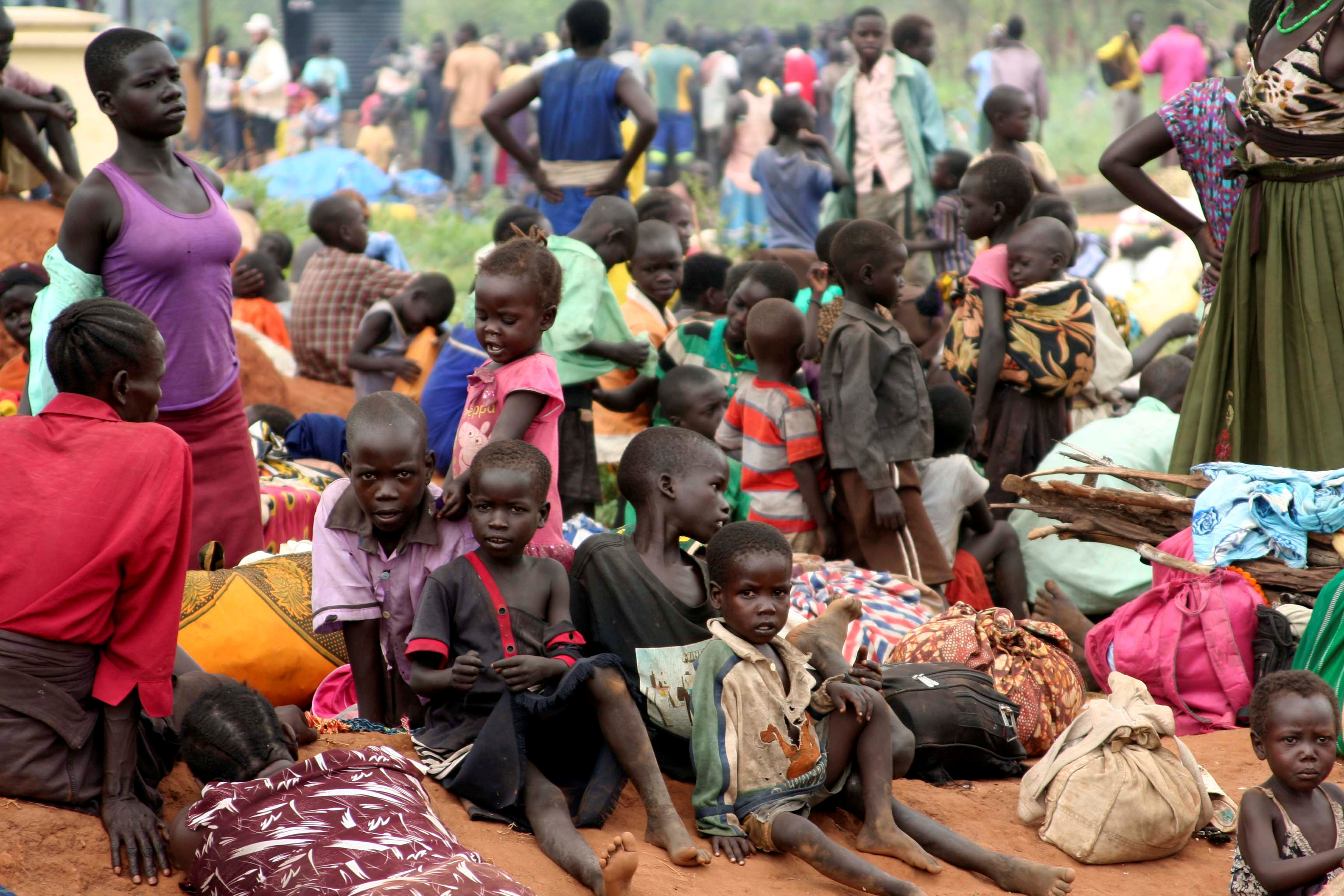 FILE PHOTO: South Sudanese refugees gather with their belongings after crossing into Uganda at the Ngomoromo border post in Lamwo district, northern Uganda, April 4, 2017. REUTERS/Stringer/File photo