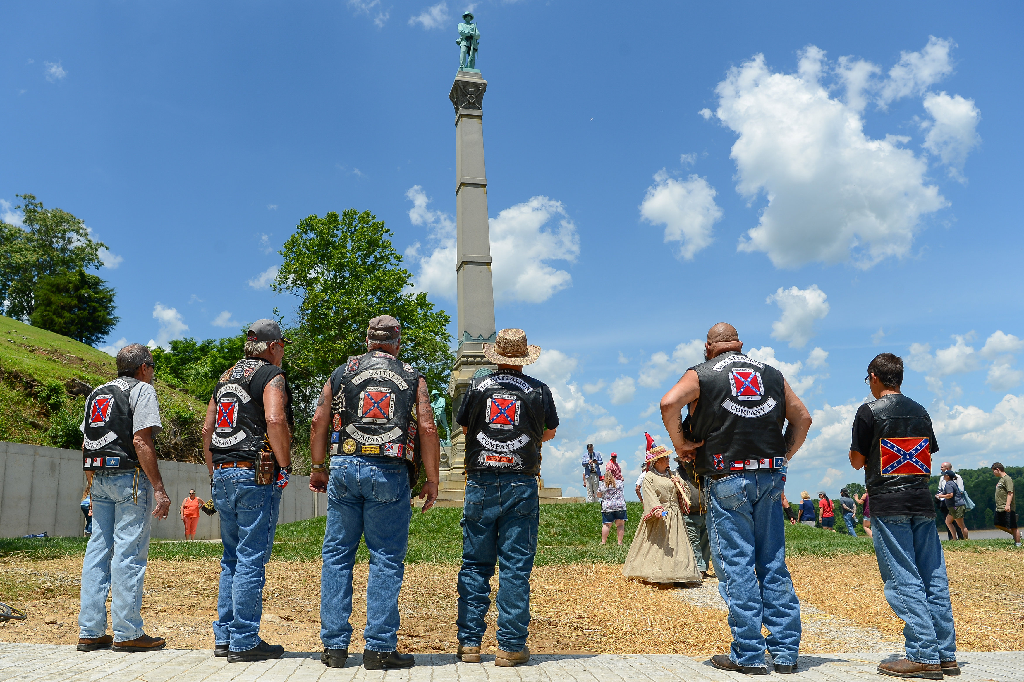 Members from The Sons of Confederate Veterans stand before a dedication ceremony in Brandenburg, Kentucky, U.S. May 29, 2017 for a Civil War Confederate Soldier Memorial recently removed from the campus of the University of Louisville. REUTERS/Bryan Woolston