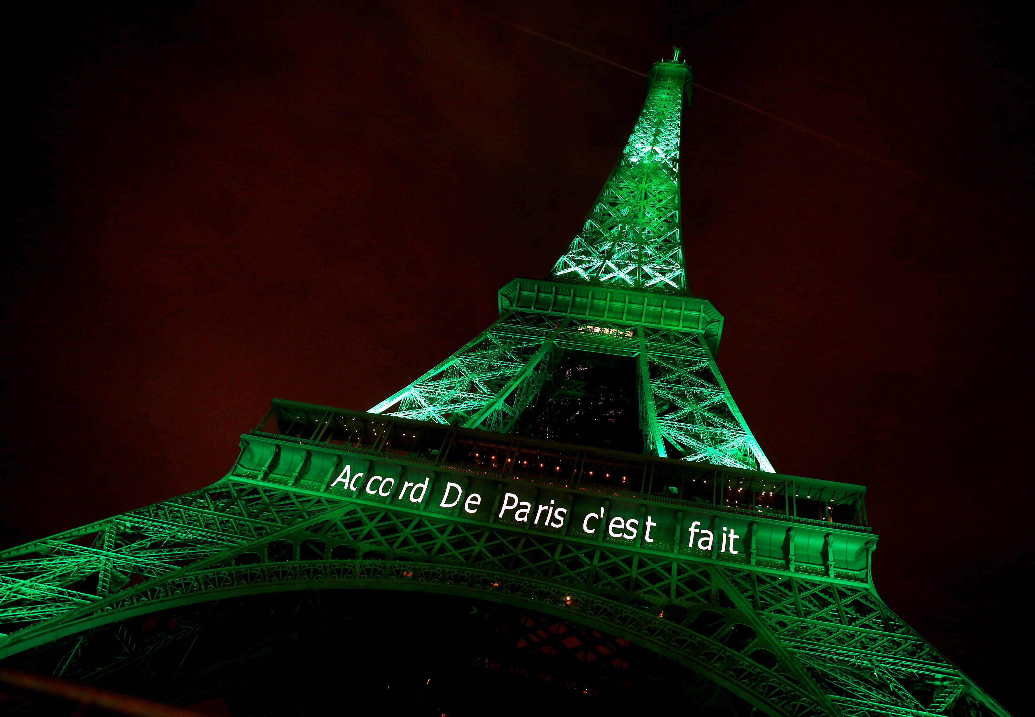 "FILE PHOTO: The Eiffel tower is illuminated in green with the words ""Paris Agreement is Done"", to celebrate the Paris U.N. COP21 Climate Change agreement in Paris, France, November 4, 2016. REUTERS/Jacky Naegelen/File Photo"
