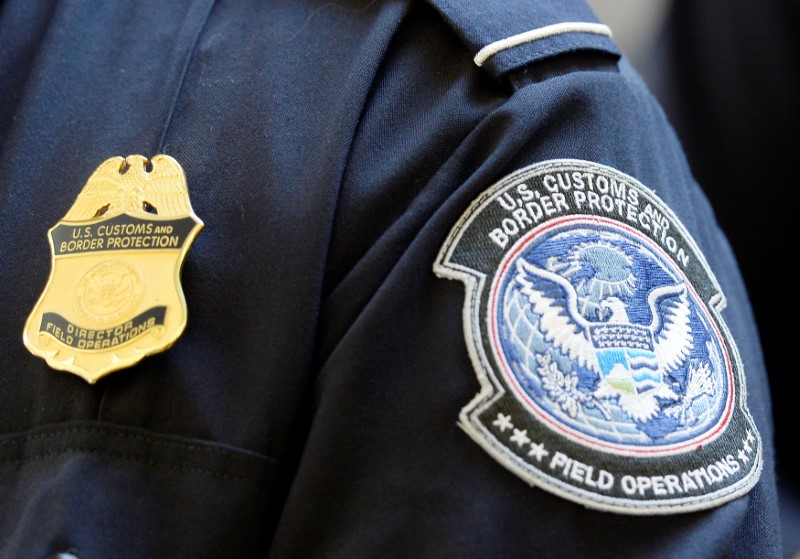 A U.S. Customs and Border Protection arm patch and badge