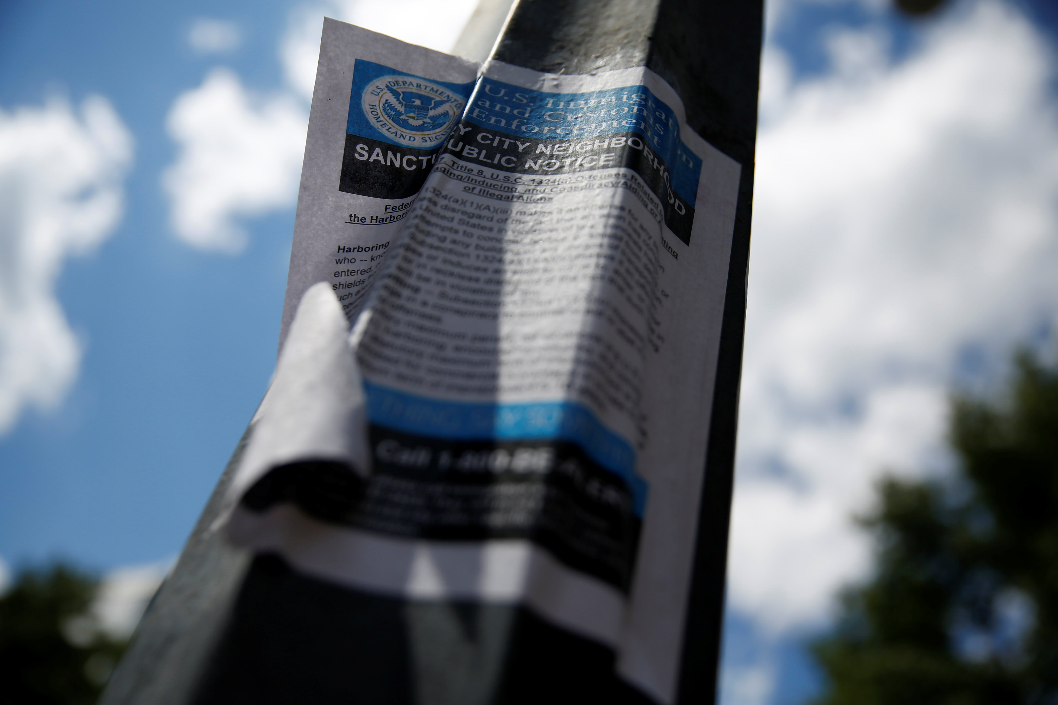 Fake government flyers urging Washington residents to turn in illegal immigrants, which city and federal officials denounced as inciting fear, are posted in Washington, U.S. June 1, 2017. REUTERS/Jonathan Ernst
