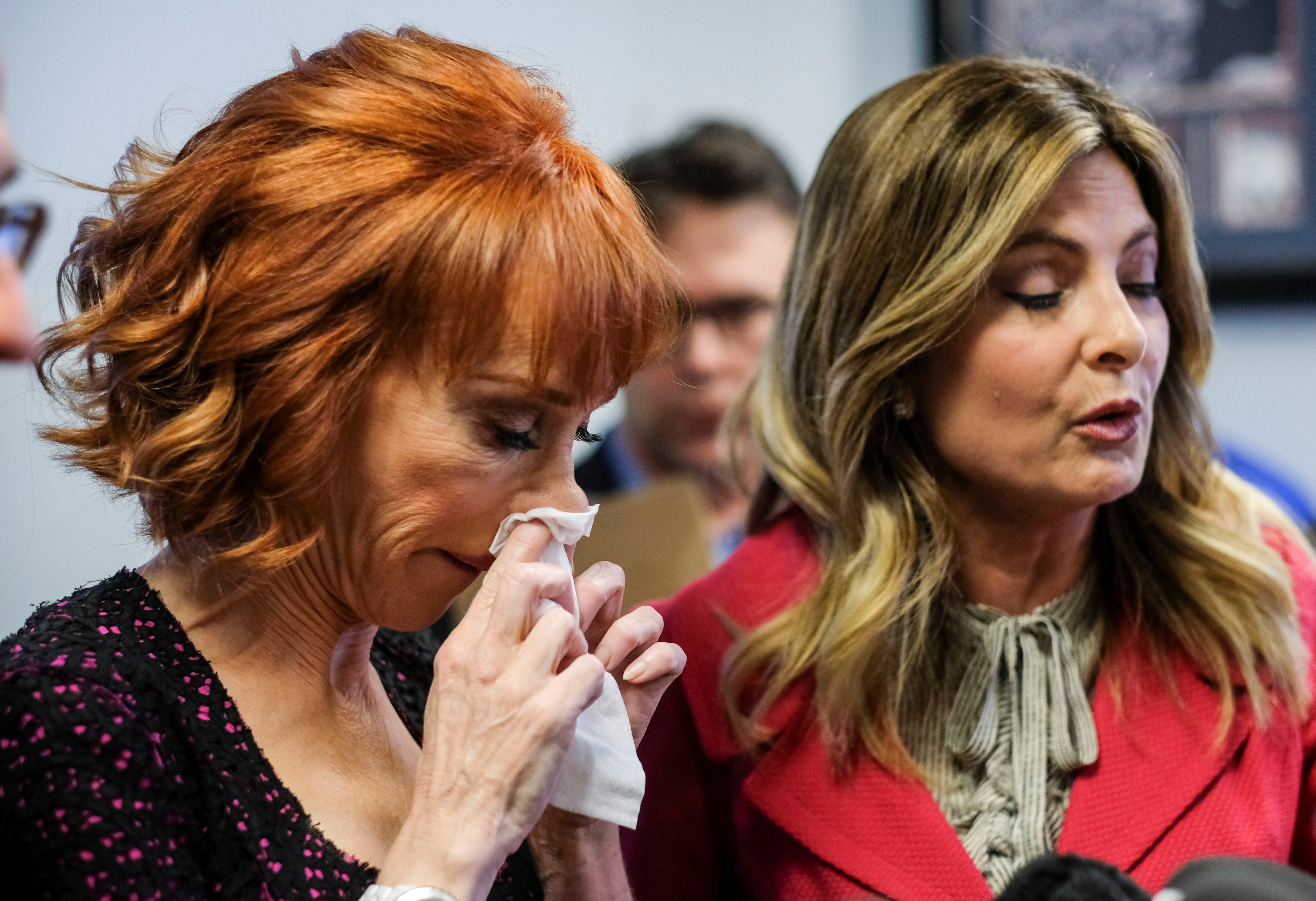 Comedian Kathy Griffin (L) wipes her nose as her attorney Lisa Bloom (R) speaks at a news conference in Woodland Hills, Los Angeles, California, U.S., June 2, 2017. REUTERS/Ringo Chiu