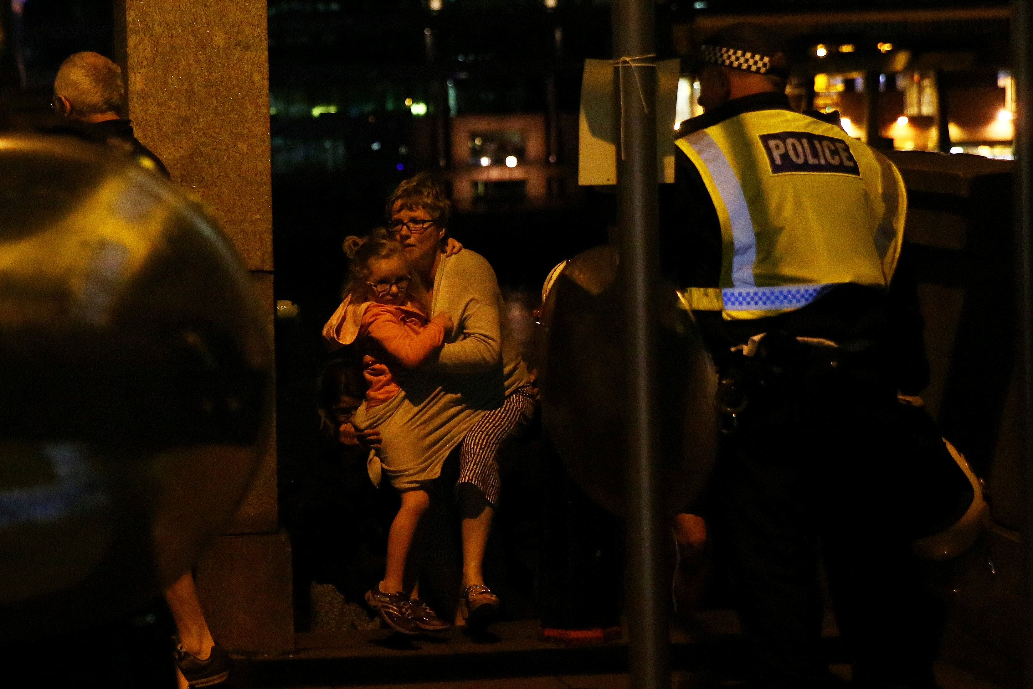 People flee as police attend to an incident near London Bridge in London, Britain, June 4, 2017. REUTERS/Neil Hall