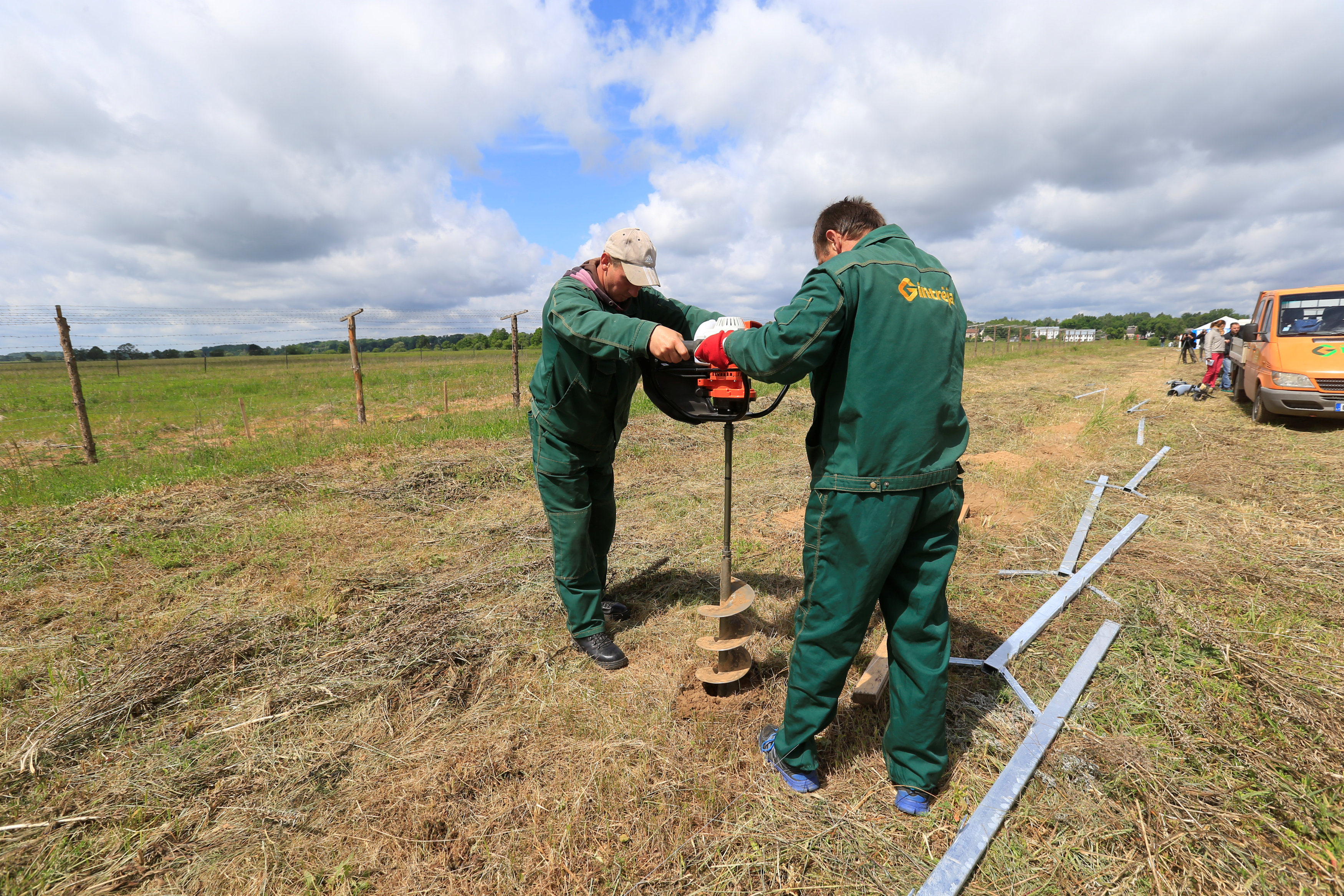 Workers drill a hole for a fence near the Sudargas border crossing point with Russia in Ramoniskiai, Lithuania June 5, 2017