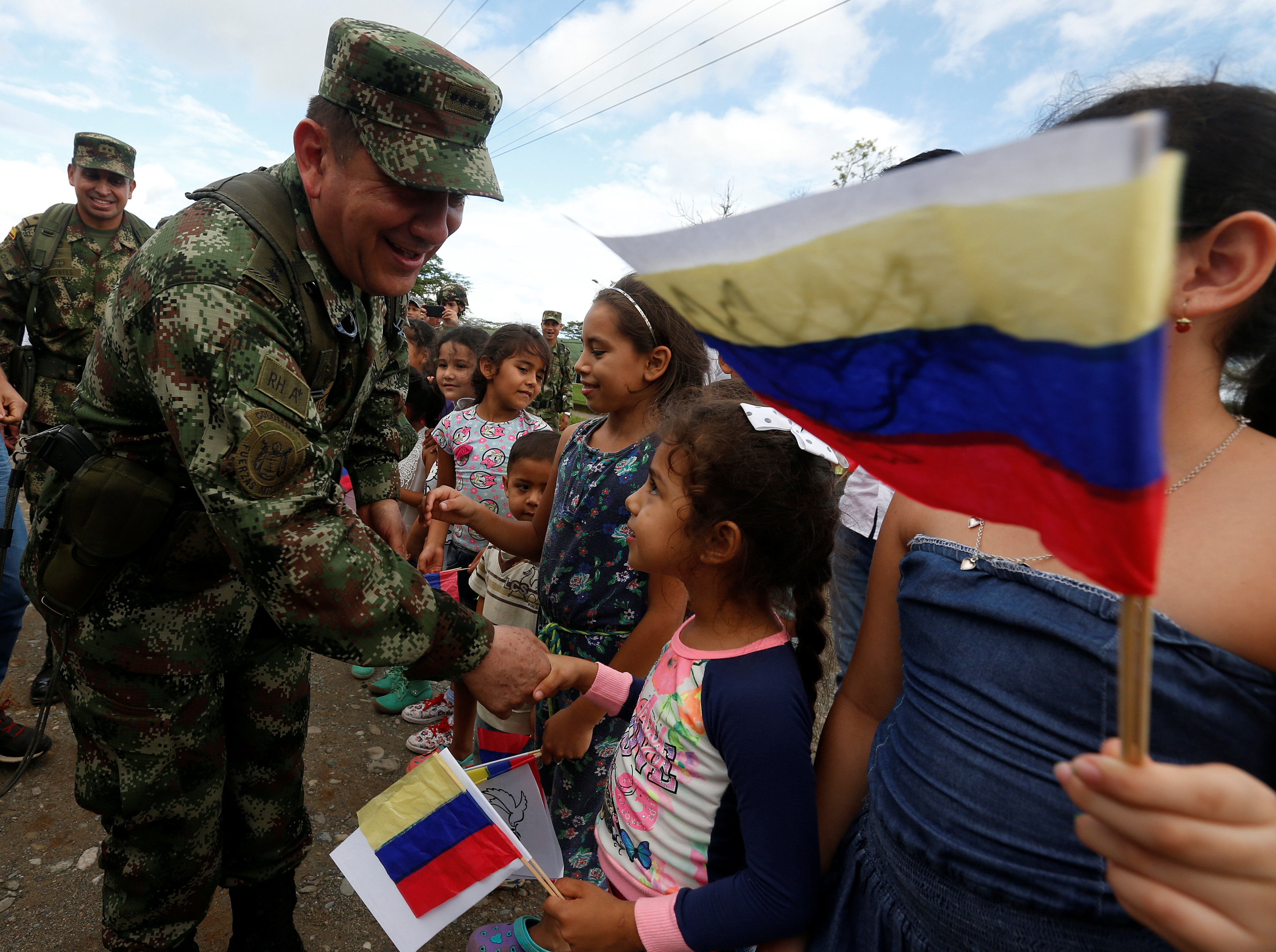 Juan Pablo Rodriguez, Commander of the Colombian Military Forces, greets children during the army's arrival to an area that was previously occupied by FARC rebels, in Meta, Colombia June 1, 2017. Picture taken June 1, 2017. REUTERS/Jaime Saldarriaga