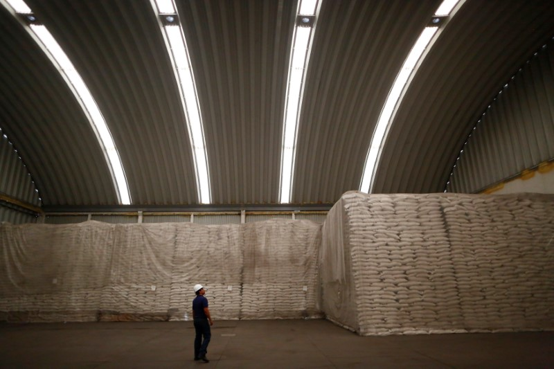 A worker looks to sacks filled with sugar at Emiliano Zapata sugar mill in Zacatepec de Hidalgo, in Morelos state, Mexico, March 7, 2015. Picture taken on March 7, 2015. REUTERS/Edgard Garrido