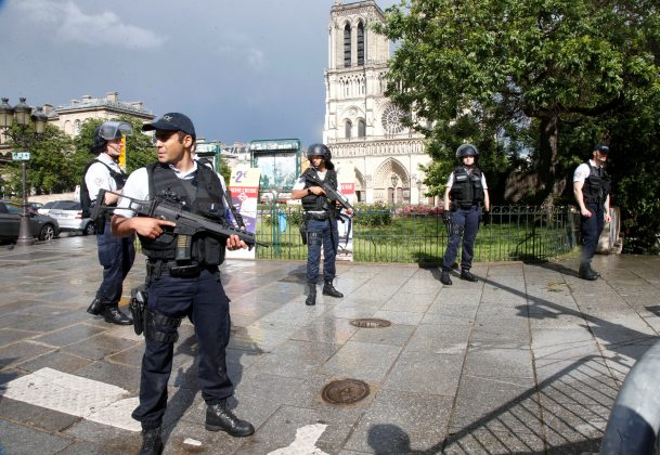 French police stand at the scene of a shooting incident near the Notre Dame Cathedral in Paris, France, June 6, 2017. REUTERS/Charles Platiau