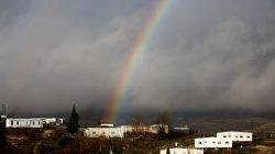 FILE PHOTO: A rainbow is seen over the Israeli settler outpost of Amona in the occupied West Bank January 31, 2017. REUTERS/Ronen Zvulun/File Photo