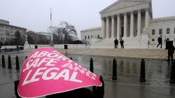 FILE PHOTO -- A woman holds a sign in the rain as abortion rights protestors arrive to prepare for a counter protest against March for Life anti-abortion demonstrators on the 39th anniversary of the Roe vs Wade decision, in front of the U.S. Supreme Court building in Washington, January 23, 2012. REUTERS/Jonathan Ernst/File PhotoFILE PHOTO -- A woman holds a sign in the rain as abortion rights protestors arrive to prepare for a counter protest against March for Life anti-abortion demonstrators on the 39th anniversary of the Roe vs Wade decision, in front of the U.S. Supreme Court building in Washington, January 23, 2012. REUTERS/Jonathan Ernst/File Photo