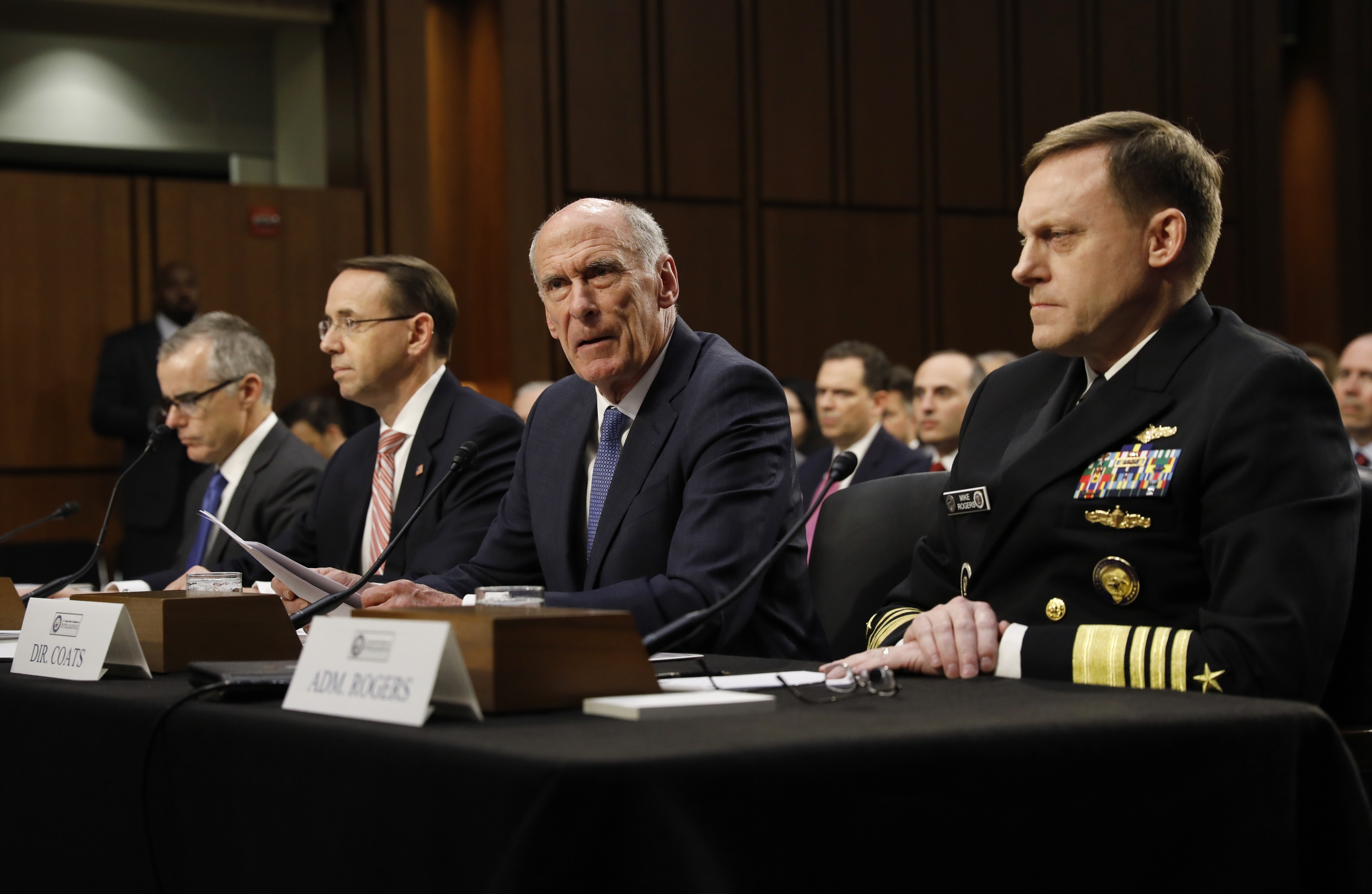 Director of National Intelligence Daniel Coats (2nd-R) testifies as he appears alongside acting FBI Director Andrew McCabe (L), Deputy Attorney General Rod Rosenstein (2nd-L) and National Security Agency Director Michael Rogers (R) at a Senate Intelligence Committee hearing on the Foreign Intelligence Surveillance Act (FISA) in Washington, U.S., June 7, 2017. REUTERS/Kevin Lamarque
