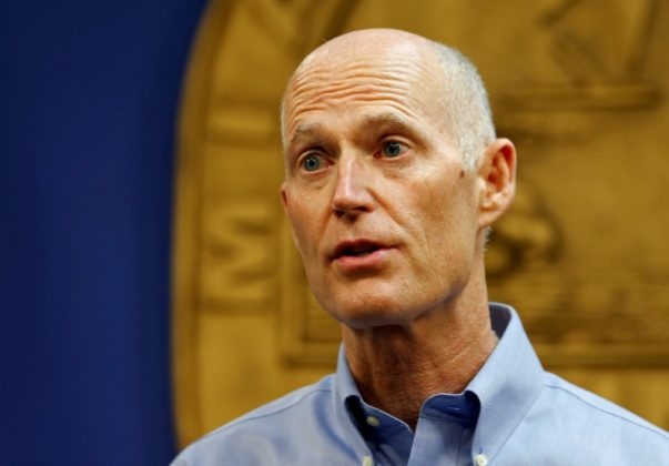 FILE PHOTO - Florida Gov. Rick Scott speaks at a press conference about the Zika virus in Doral, Florida, U.S. August 4, 2016. REUTERS/Joe Skipper/File Photo