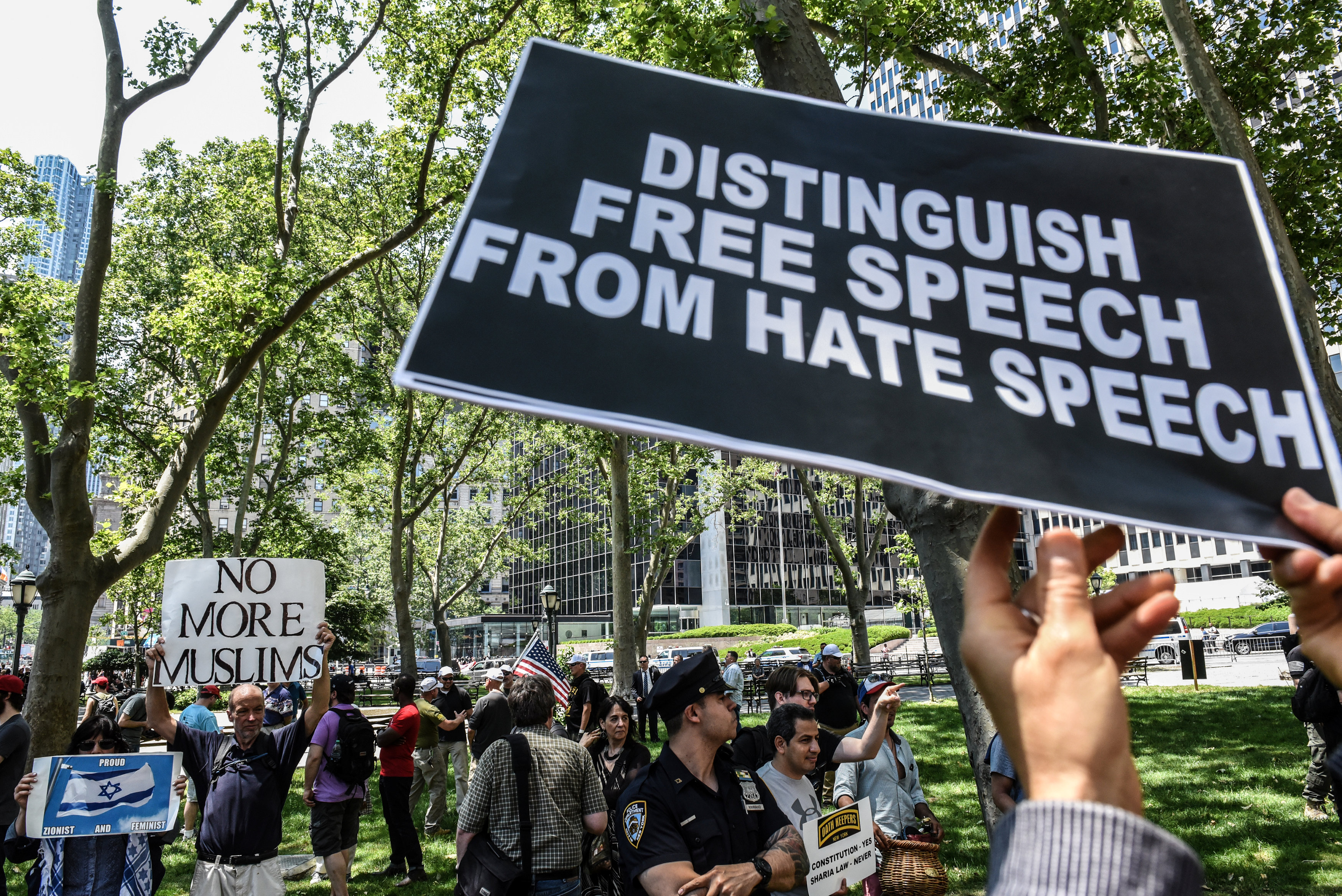 "People hold signs while participating in an event called ""March Against Sharia"" in New York City, U.S."