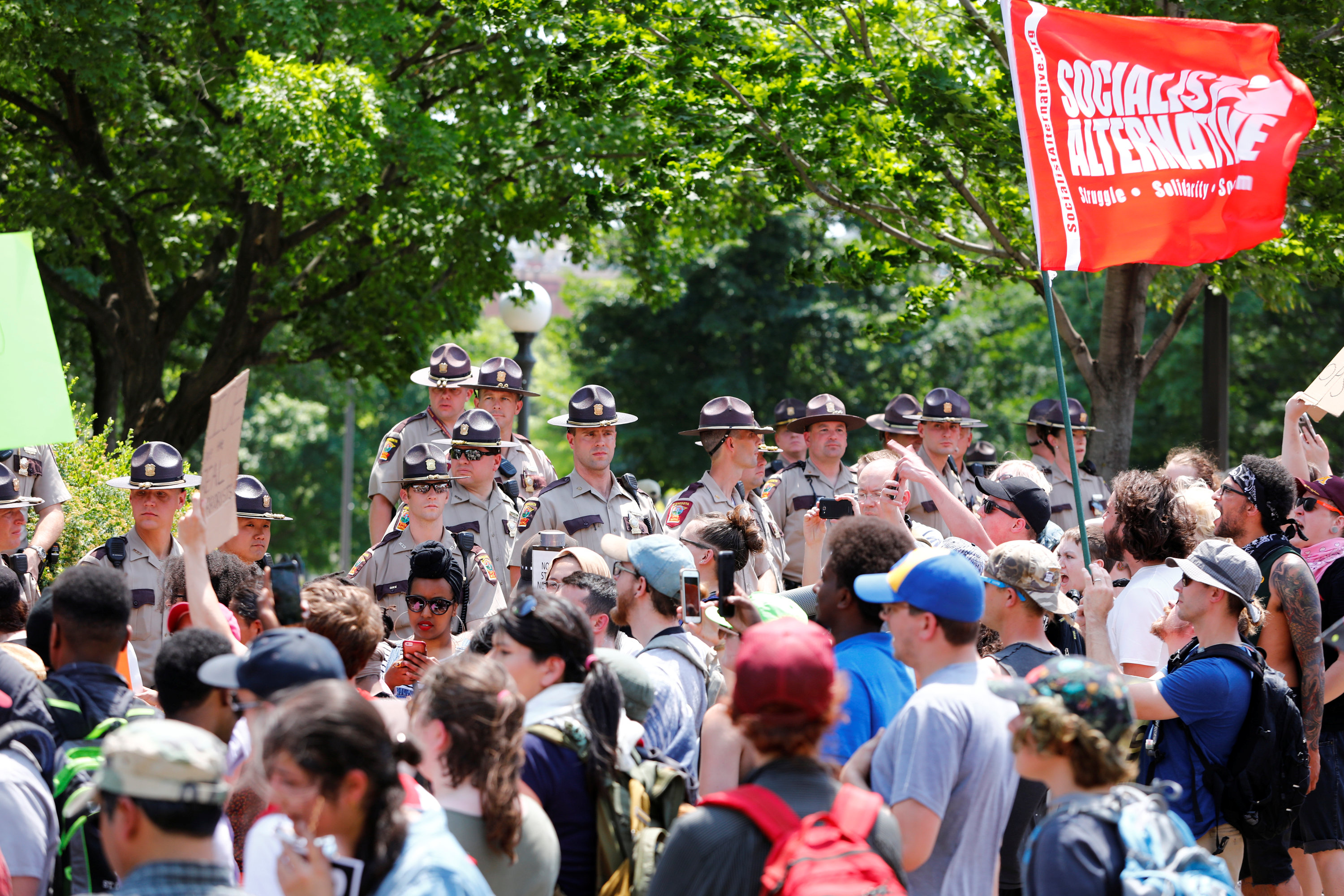 Anti-sharia protesters scuffle with counter demonstrators and members of the Minnesota State Patrol at the state capitol in St. Paul, Minnesota,
