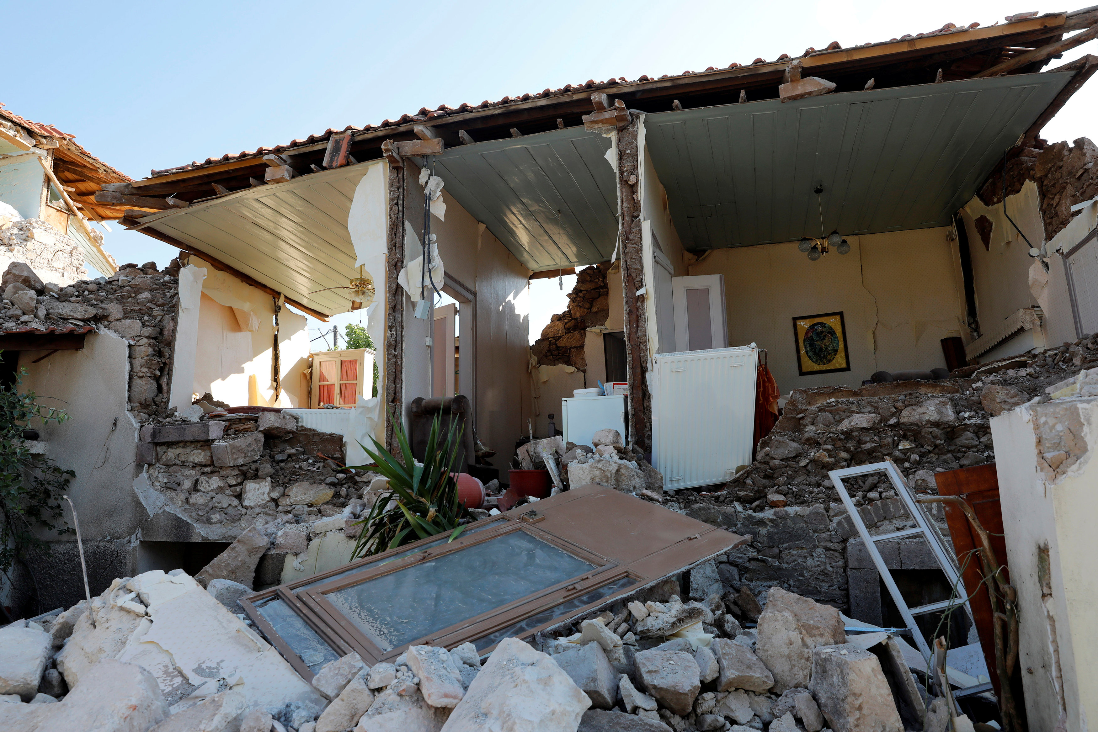 A damaged house is seen at the village of Vrissa on the Greek island of Lesbos, Greece, after a strong earthquake shook the eastern Aegean