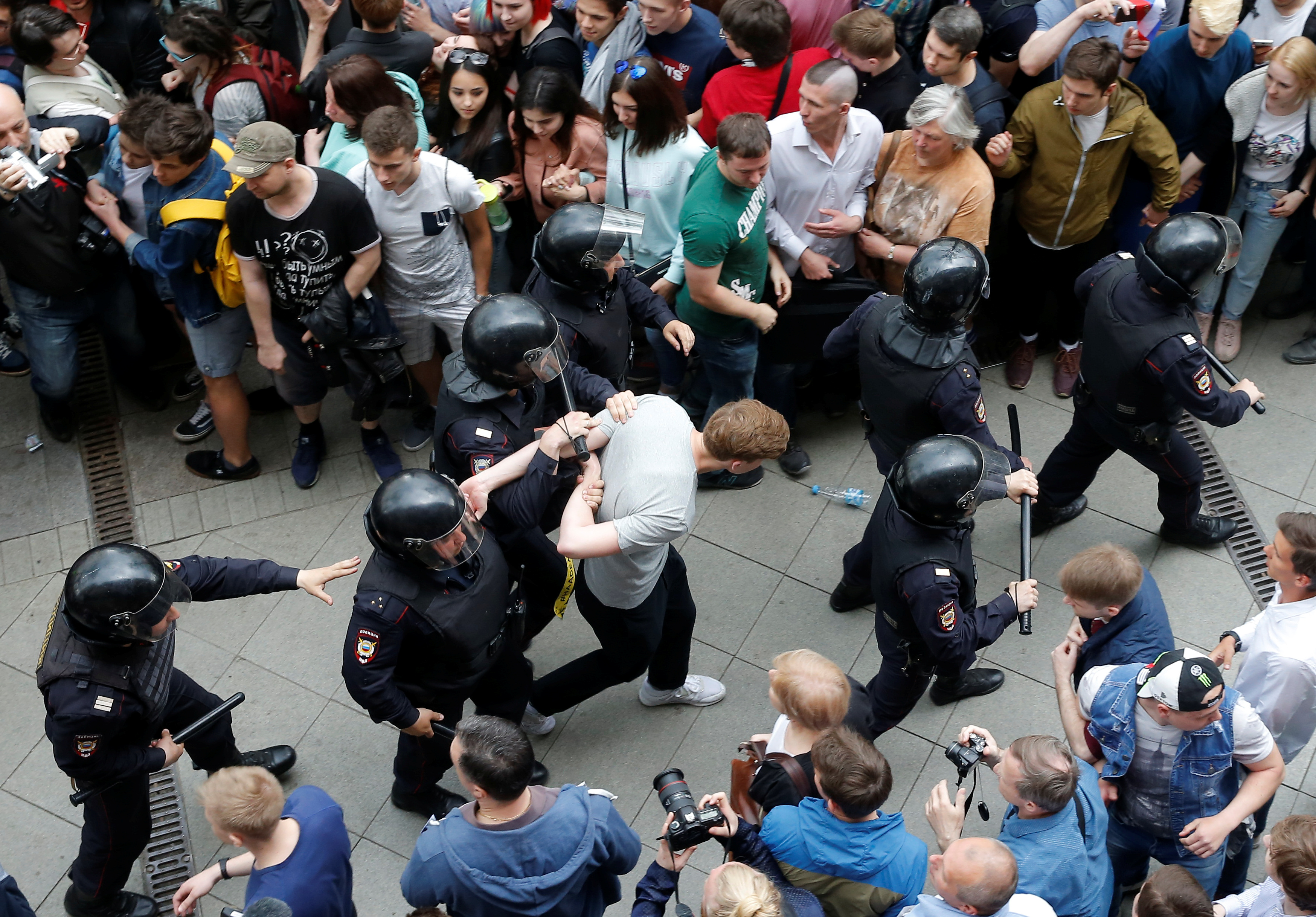 Riot police detain a demonstrator during an anti-corruption protest organised by opposition leader Alexei Navalny, on Tverskaya Street in central Moscow.