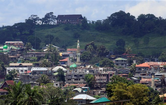 Damaged buildings and houses are seen at Moncado Colony village after intense fighting between government troops against insurgents from the Maute group, who have taken over large parts of Marawi city, Philippines, June 13, 2017. REUTERS/Romeo Ranoco