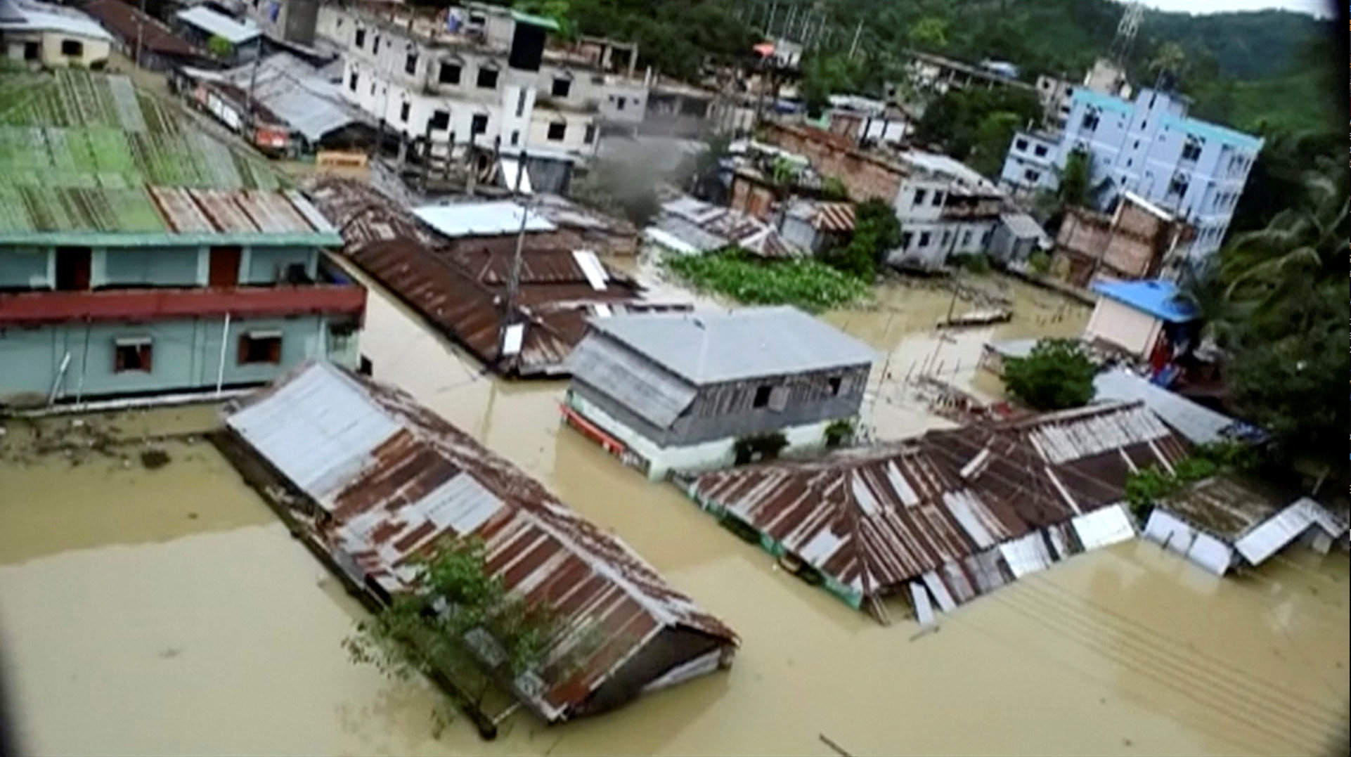 An aerial view showing the town half-submerged in floodwaters following landslides triggered by heavy rain in Khagrachari, Bangladesh, in this still frame taken from video June 13, 2017. REUTERS/REUTERS TV