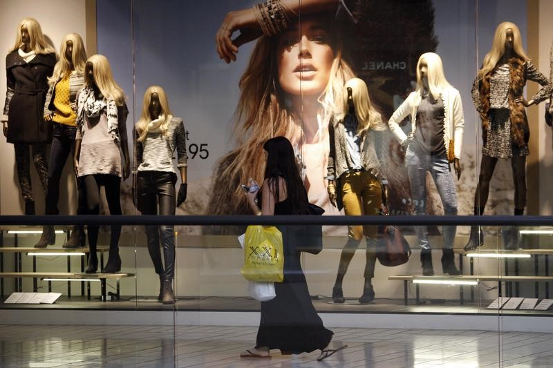 A shopper passes a window display at the Beverly Center mall in Los Angeles, California November 8, 2013. REUTERS/David McNew