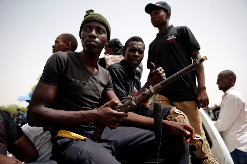 Members of the local militia, otherwise known as CJTF, sit in the back of a truck during a patrol in the city of Maiduguri, northern Nigeria June 9, 2017. Picture taken June 9, 2017. REUTERS/Akintunde Akinleye.