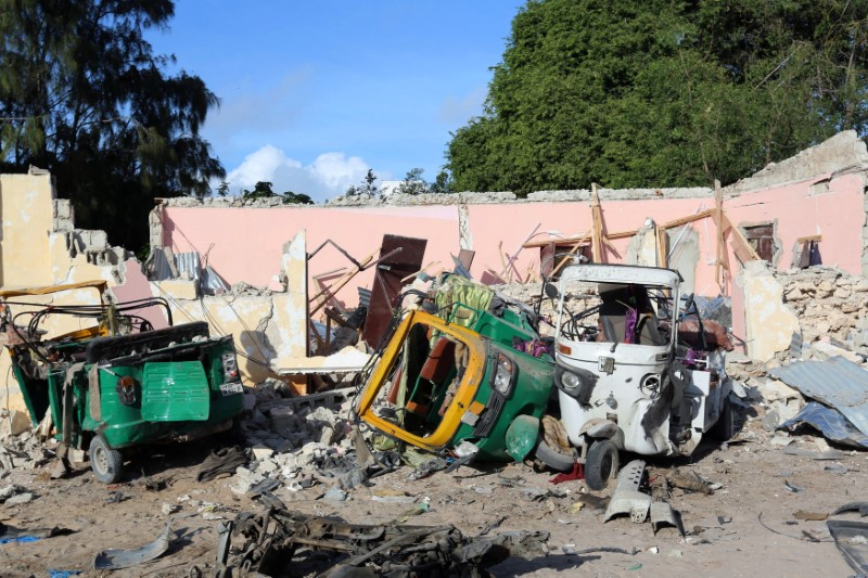 Damaged vehicles are seen at the scene of an attack outside a hotel and an adjacent restaurant in Mogadishu, Somalia June 15, 2017. REUTERS/Stringer