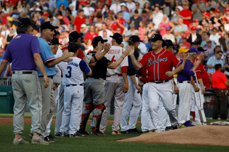 Rep. Barry Loudermilk (R-GA) greets team mates during the Congressional Baseball Game at Nationals Park in Washington, U.S., June 15, 2017. REUTERS/Aaron P. Bernstein