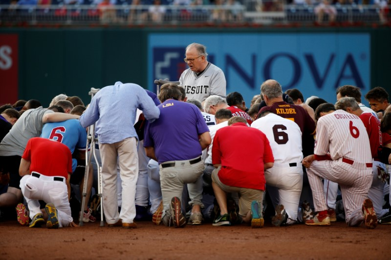 Patrick Conroy, Chaplain of the House of Representatives, leads Democrats and Republicans in prayer before they face off in the annual Congressional Baseball Game at Nationals Park in Washington, U.S., June 15, 2017. REUTERS/Joshua Roberts