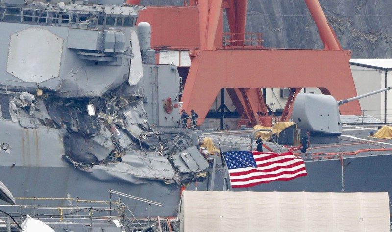 The Arleigh Burke-class guided-missile destroyer USS Fitzgerald, damaged by colliding with a Philippine-flagged merchant vessel, is seen at the U.S. naval base in Yokosuka, Japan,