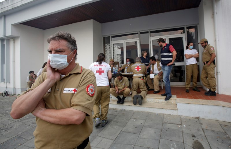 Red Cross and other relief personnel are seen outside a relief centre for people affected by a forest fire in Figueiro dos Vinhos, Portugal, June 19, 2017.