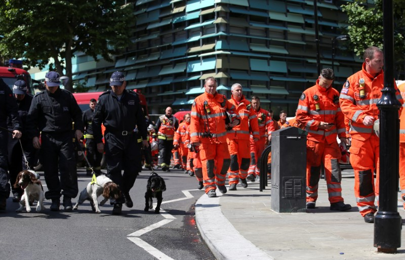 Members of the emergency services arrive to attend a minute's silence for the victims of the Grenfell Tower fire near the site of the blaze in North Kensington, London, Britain, June 19, 2017