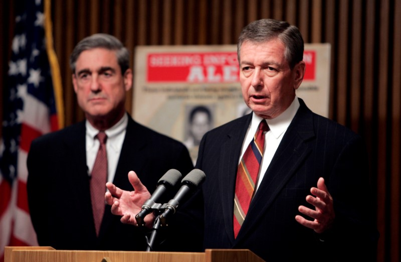 FILE PHOTO -- U.S. Attorney General John Ashcroft (R) and FBI Director Robert Mueller speak about possible terrorist threats against the United States, in Washington, May 26, 2004