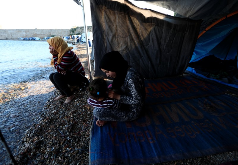 "Faten 25, (L) from Syria, sits at the edge of the beach beside her sister-in-law near their tent outside the Souda refugees camp in Chios Island, Greece, June 10, 2017. ""It's taking too long. This slowness to reunite families scares me,"" Faten said. ""We have nothing to do all day long, we just sit by the tent which I share with my sister-in-law, a friend and her daughter."""