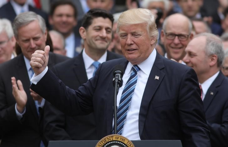 FILE PHOTO - U.S. President Donald Trump (C) acknowledges House Speaker Paul Ryan (3rdL) as he gathers with Congressional Republicans in the Rose Garden of the White House after the House of Representatives approved the American Healthcare Act, to repeal major parts of Obamacare and replace it with the Republican healthcare plan, in Washington, U.S., May 4, 2017. REUTERS/Carlos Barria
