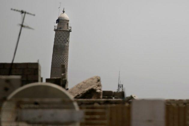 A black jihadist flag hangs from Mosul's Al-Habda minaret at the Grand Mosque, where Islamic State leader Abu Bakr al-Baghdadi declared his caliphate back in 2014, in western Mosul, Iraq May 29, 2017. REUTERS/Alkis Konstantinidis
