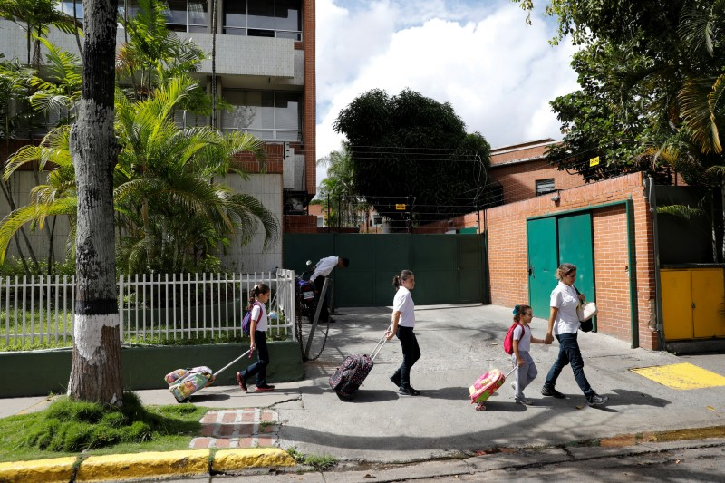 Caribay Valenzuela (R), walks with her daughters (L-R) Carlota, Eloisa and Carmen, after picking them up on the school on a day of protests in Caracas, Venezuela June 19, 2017. REUTERS/Carlos Garcia Rawlins