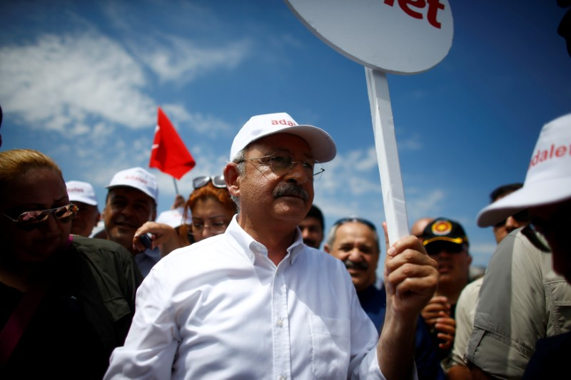"FILE PHOTO: Turkey's main opposition Republican People's Party (CHP) leader Kemal Kilicdaroglu walks during a protest, dubbed ""justice march"", against the detention of his party's lawmaker Enis Berberoglu, on the outskirts of Ankara, Turkey June 17, 2017. REUTERS/Osman Orsal/File Photo"