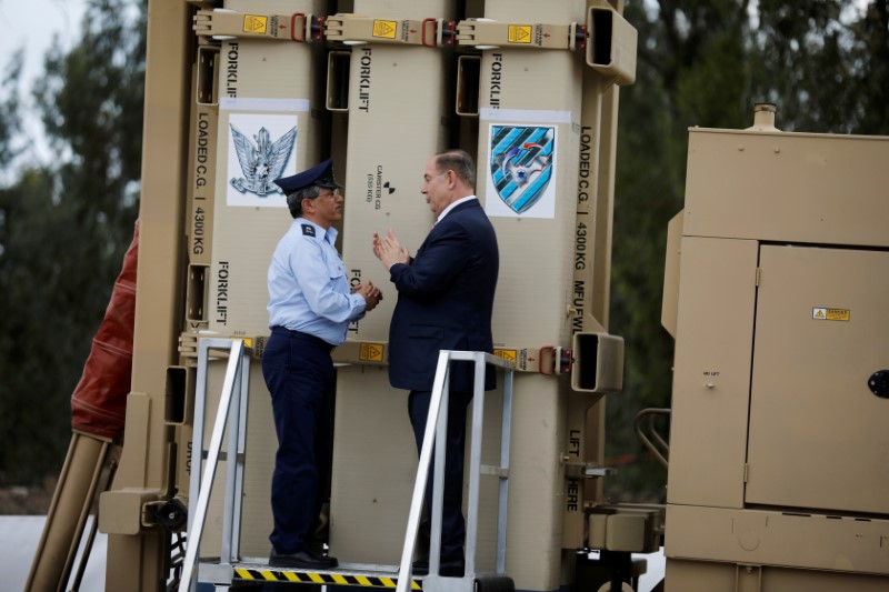 "Israeli Prime Minister Benjamin Netanyahu (R) speaks with Amir Eshel, commander of the Israeli Air Force, as they stand next to a David's Sling launcher system during a ceremony in which Israel declared its ""David's Sling"" intermediate-range air defence shield fully operational, at Hatzor air base in southern Israel April 2, 2017. REUTERS/Amir Cohen"